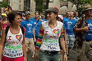 A mother and gay daughter marching in the 2011 Pride Parade on New York's Fifth Avenue.