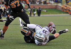 Nov 13, 2010; Columbia, MO, USA; Kansas State Wildcats running back John Hubert (33) is tackled by Missouri Tigers linebacker Andrew Gachkar (6) in the first half at Memorial Stadium. Missouri won 38-28.  Mandatory Credit: Denny Medley-US PRESSWIRE