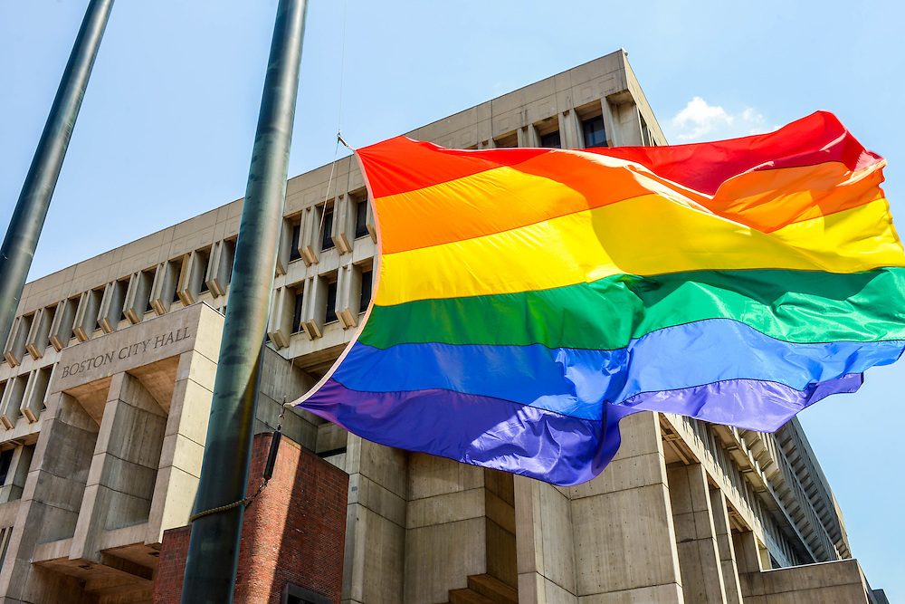 The Pride flag is raised in front of Boston City Hall at the beginning of Pride Week.