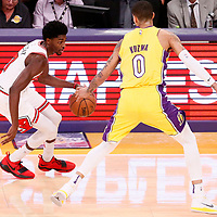 21 November 2017: Chicago Bulls guard Justin Holiday (7) drives past Los Angeles Lakers forward Kyle Kuzma (0) during the LA Lakers 103-94 victory over the Chicago Bulls, at the Staples Center, Los Angeles, California, USA.