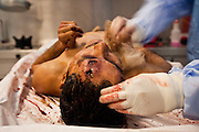 WARNING GRAPHIC CONTENT: A Forensic expert perform an autopsy on a victim of a drug shooting at the Juarez City Forensic Lab in Juarez, Mexico January 16, 2009.  An ongoing drug war has already claimed more than 40 people since the start of the year. More than 1600 people were killed in Juarez in 2008, making Juarez the most violent city in Mexico.    (Photo by Richard Ellis)