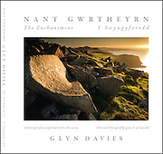 For landscape photo-artist Glyn Davies, the lost valley of Nant Gwrtheyrn, hidden away on the north-west coast of Wales, was a place of mysterious childhood memories. Then he met Dr Carl Clowes, whose work in the 1970s helped turn the deserted granite-quarrying village into a centre for Welsh language and culture. Their initial co-operation on the production of an illustrated guide-book became, for Glyn, the catalyst for a far more extensive project.<br /> <br /> Nant's human history goes back at least two thousand years; this collection marks yet another period, immediately prior to the next stage in its development. Additional material from Carl Clowes sets the Nant in its historical context, some of it shaped by his own vision.<br /> <br /> But this is essentially one man's response to the many facets of this haunting valley. Glyn's rediscovery of Nant, and his photographic exploration of it, decades after his first visit, have been a complete revelation for him. As he recounts here, for him, it has meant a 'sense of past', solitude and spiritual awareness. It has dramatically influenced his response to landscape, history, cultural identity and language.<br /> <br /> If you know the Nant, you have almost certainly fallen under its spell. If this is your first contact with it as more than a name, Glyn's rich and personal images, even more eloquently than his words, will draw you to it.