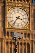 A traffic CCTV camera mounted in front of the clockface containing the Big Ben bell in the Elizabeth Tower of the British parliament, on 17th January 2017, in London England. The Elizabeth Tower (previously called the Clock Tower) named in tribute to Queen Elizabeth II in her Diamond Jubilee year – was raised as a part of Charles Barry's design for a new palace, after the old Palace of Westminster was largely destroyed by fire on the night of 16 October 1834. The new Parliament was built in a Neo-gothic style. Although Barry was the chief architect of the Palace, he turned to Augustus Pugin for the design of the clock tower. It celebrated its 150th anniversary on 31 May 2009. The tower was completed in 1858 and has become one of the most prominent symbols of both London and England.