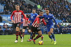 Southampton's Yan Valery tackles Cardiff City's Josh Murphy during the Premier League match at the Cardiff City Stadium, Cardiff.