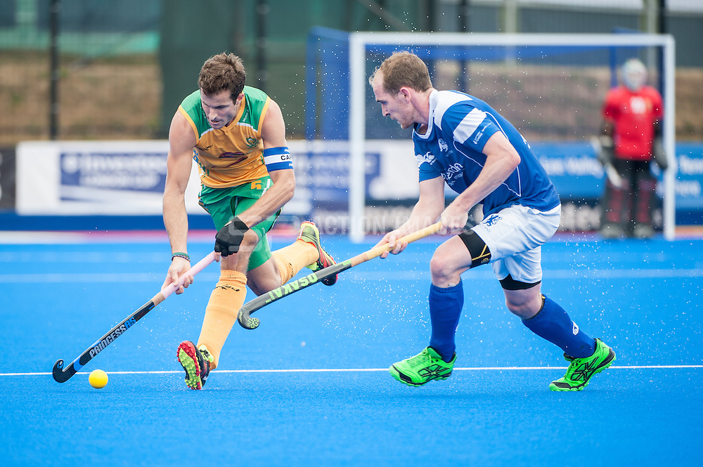 Austin Smith (RSA) is challenged by Gordon McIntyre (SCO). Scotland v South Africa, 3rd/4th play-off, Investec London Cup, Lee Valley Hockey & Tennis Centre, London, UK on 13 July 2014. Photo: Simon Parker