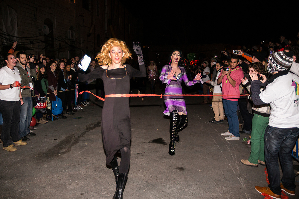 Israeli drag queens take part in a 'Drag Race' organized by The Jerusalem LGBT (lesbian, gay bisexual and transgender) community, in which competitors raced down a 50 meter stretch, wearing high heels, in central Jerusalem, Israel, on February 16, 2015. The event is part of the city's annual 'Winter Noise Festival' also dubbed 'Sound of Winter Festival' which features street performances, open bars and street art exhibitions.