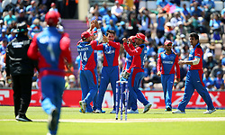 Afghanistan's Rahmat Shah (centre) celebrates dismissing India's Vijay Shankar during the ICC Cricket World Cup group stage match at the Hampshire Bowl, Southampton.