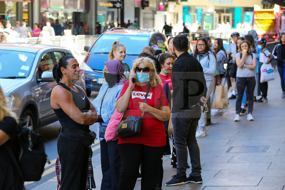 © Licensed to London News Pictures. 15/06/2020. London, UK. Shoppers queue outside H&M in Wood Green, north London as non-essential stores reopen after three months of COVID-19 lockdown. Photo credit: Dinendra Haria/LNP