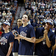 Katie Lou Samuelson, (center), UConn, is congratulated by team mates after making the tournament team during the UConn Huskies Vs USF Bulls 2016 American Athletic Conference Championships Final. Mohegan Sun Arena, Uncasville, Connecticut, USA. 7th March 2016. Photo Tim Clayton
