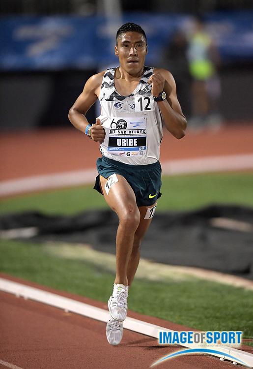 Apr 19, 2018; Torrance, CA, USA; Antonio Uribe wins 10,000m heat in 29:18.66 during the 60th Mt. San Antonio College Relays] at Murdock Stadium.