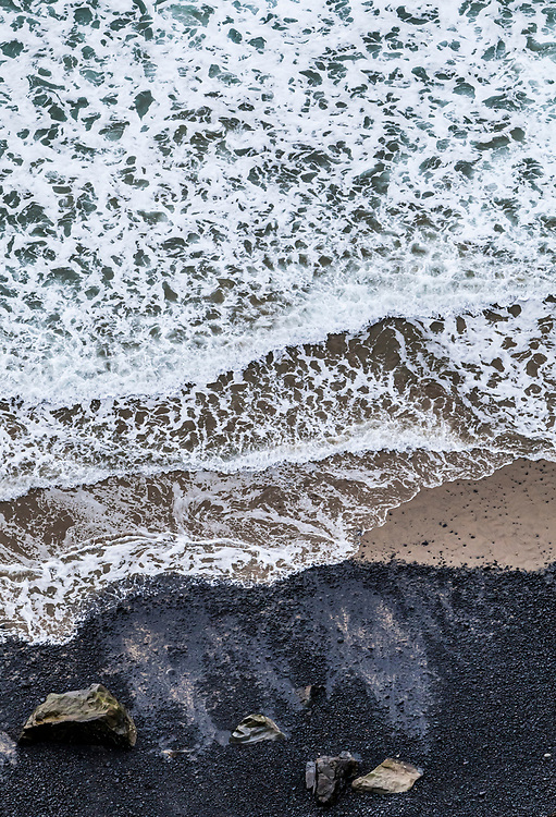 Looking down on waves as they come ashore, Ecola State Park, Oregon, USA.