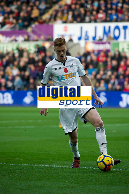 Football - 2017 / 2018 Premier League - Swansea City vs. Brighton & Hove Albion<br /> <br /> Sam Clucas of Swansea City on the ball, at The Liberty Stadium.<br /> <br /> COLORSPORT/WINSTON BYNORTH