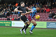 Yanic Wildschut of Wigan Athletic and Jordan Clarke of Scunthorpe United fight for the ball during the Sky Bet League 1 match between Scunthorpe United and Wigan Athletic at Glanford Park, Scunthorpe, England on 2 January 2016. Photo by Ian Lyall.