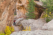 Obadiah Reid hikes through Arch Rocks along Fern Lake Trail, Rocky Mountain National Park, Colorado.