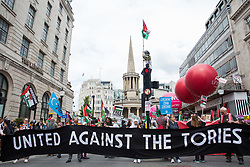 Thousands of people attend a United Against The Tories national demonstration organised by the People's Assembly Against Austerity in protest against the policies of Prime Minister Boris Johnson's Conservative government on 26th June 2021 in London, United Kingdom. The demonstration contained blocs from organisations and groups including Palestine Solidarity Campaign, Stand Up To Racism, Stop The War Coalition, Extinction Rebellion, Kill The Bill and Black Lives Matter as well as from trade unions Unite and the CWU.