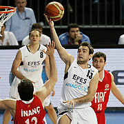 Efes Pilsen's Ender ASLAN (2ndR) during their Turkish Basketball league match Efes Pilsen between Tofas at the Sinan Erdem Arena in Istanbul Turkey on Sunday 27 February 2011. Photo by TURKPIX