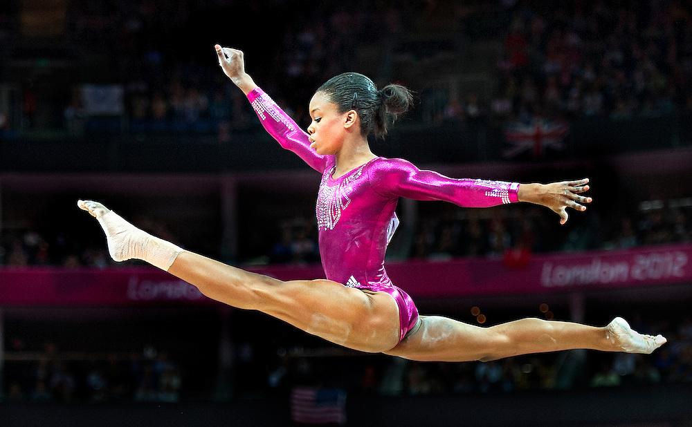 Engeland, Londen, 02-08-2012.<br /> Olympische Spelen.<br /> Turnen, Balk, Vrouwen, Meerkamp.<br /> Gabrielle Douglas uit de Verenigde Staten van Amerika tijdens haar oefening op de balk. Douglas wordt olympisch kampioen.<br /> Foto : Klaas Jan van der Weij