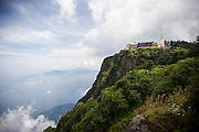 The statue of golden elephant and Buddha and the temple are seen on the top of the Buddhist Sacred Mountain on Emei Shan  (Chinese: 峨眉山市 ; pinyin: Éméishānshì) in Emei, near Chengdu, China, August 13, 2014.<br /> <br /> Confucianism, Taoism and Buddhism are the three major religions in China. Temples and statues witness their ancient roots all over the Chinese country.<br /> <br /> © Giorgio Perottino
