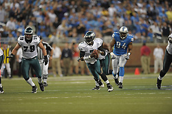 DETROIT - SEPTEMBER 19: Quarterback Michael Vick #7 of the Philadelphia Eagles scrambles during the game against the Detroit Lions on September 19, 2010 at Ford Field in Detroit, Michigan. (Photo by Drew Hallowell/Getty Images)  *** Local Caption *** Michael Vick
