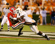 Georgia WR Mohamed Massaquoi is tackled by UT DB Demetrice Morley during the game between the Georgia Bulldogs and the Tennessee Volunteers at Sanford Stadium in Athens, GA on October 7, 2006.<br />