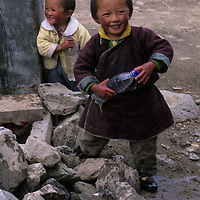 CHINA, TIBET. Children in Lunang Valley village prepare for a water fight.