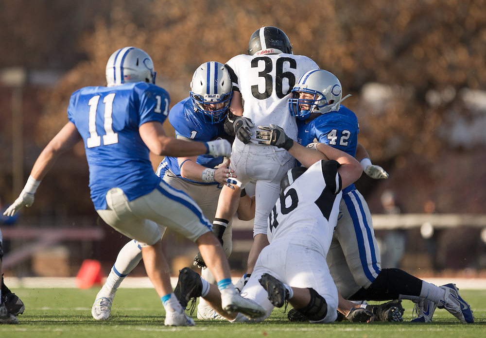 Henry Nelson and Gabe Salzer, of Colby College, during a NCAA Division III football game on November 8, 2014 in Waterville, ME. (Dustin Satloff/Colby College Athletics)