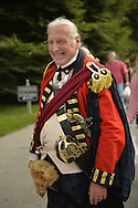 Old Westbury, New York, U.S. - August 23, 2014 - BOB SMALL, of NYC, is an American Revolution re-enactor portraying a Major in the 42nd Royal Regiment of Foote, at the 54th Annual Long Island Scottish Festival and Highland Games, co-hosted by L. I. Scottish Clan MacDuff, at Old Westbury Gardens. The regiment, The Black Watch, was raised in the Scottish Highlands in 1740 and fought for the British.