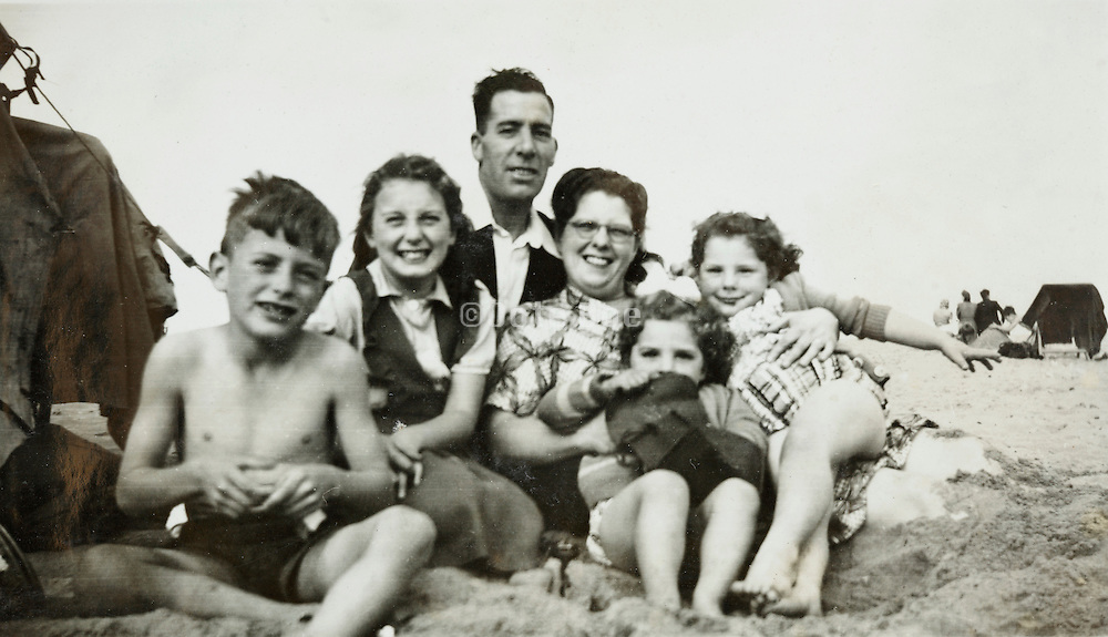 happy family scene on the beach 1950