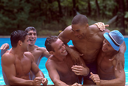 men enjoying time together in a swimming pool in East Hampton, NY