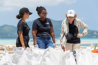 Sylvia Earle and Angelique Pouponneau and team member in Seychelles beach clean up