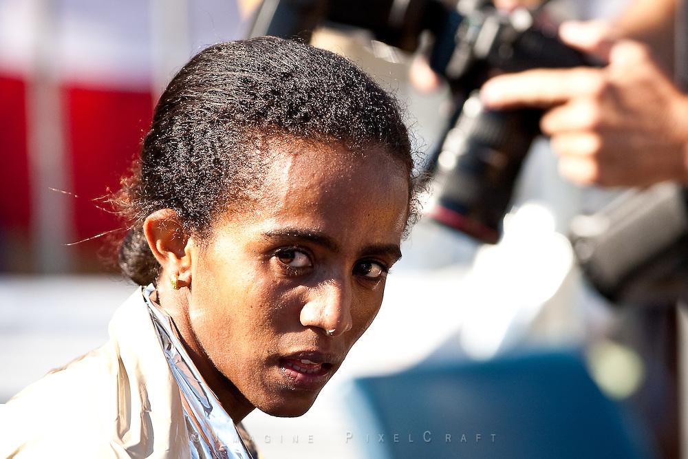 Buzunesh Deba looks back after her win at the Quad Cities Marathon 2009