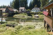 Old wooden stilt homes on Hammer Slough in Petersburg, Mitkof Island, Alaska. Petersburg settled by Norwegian immigrant Peter Buschmann is known as Little Norway due to the high percentage of people of Scandinavian origin.