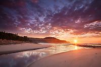 Colorful clouds light up at sunrise along the coastline of Cape Breton NP, Nova Scotia, Canada (3 stop reverse grad ND)