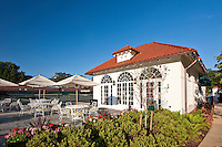 Exterior and interior photography of Columbia Country Club pools, fitness center, bowling alley, tennis courts, clubhouse, and lounge built by Coakley Williams Construction
