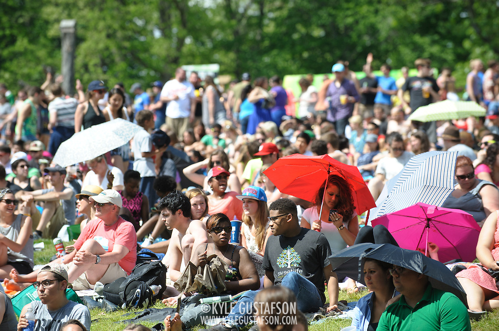 COLUMBIA, MD - May 11th, 2013 - Concert goers use umbrellas to shield themselves from the sun at the 2013 Sweetlife Food and Music Festival at Merriweather Post Pavilion in Columbia, MD. (Photo by Kyle Gustafson / For The Washington Post)