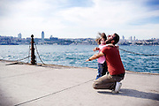 A Turkish father hugs her daughter on the Bosphorus coast in Kadikoy district in Istanbul, Turkey, June 15, 2009.<br /> <br /> This image is part of the series 'Bos-for-Us: Daily life on Istanbul Bosphorus'.<br /> <br /> © Giorgio Perottino