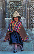 Tribal indigenous girl begging outside the cathedral, Cochabamba, Lake Titicaca, Bolivia