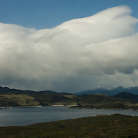 Clouds billow over Lago Sarmiento in Torres del Paine National Park in Patagonia, Chile.