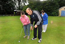 Young people with learning disabilities playing pitch and putt; as part of a Sport Ability Day North Yorkshire, UK