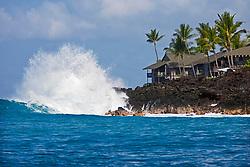 Unusual high surf in leeward, Kona, crashing on lava rocks and thrreatening luxury condominiums behind, Keauhou Bay, Kona Coast, Big Island, Hawaii, Pacific Ocean