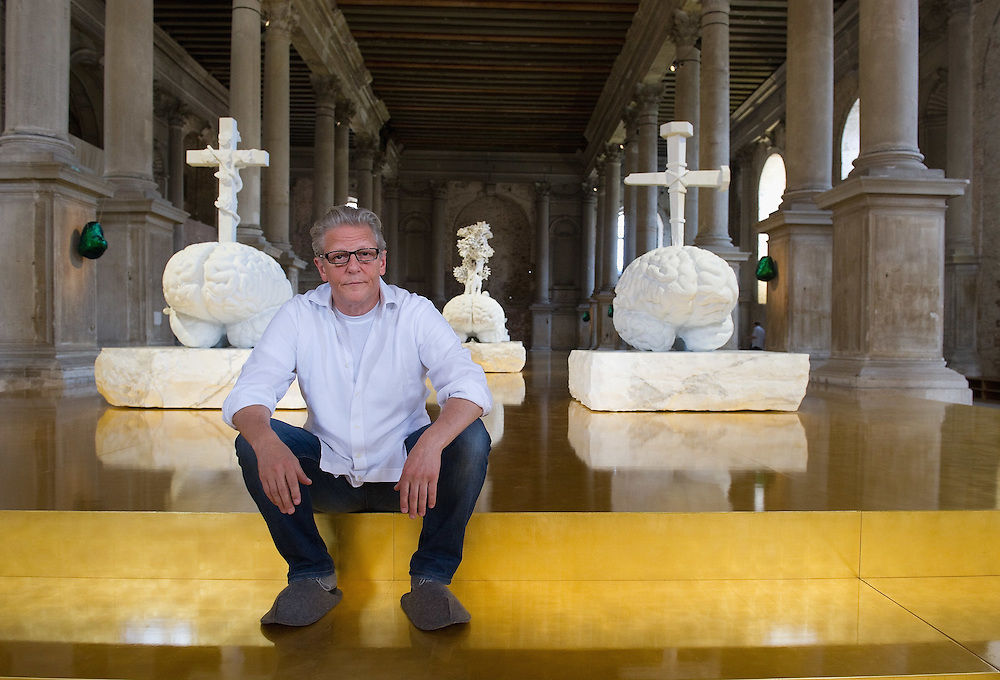 VENICE, ITALY - MAY 31:  Flemish artist Jan Fabre poses inside and outside Nuova Scuola Grande di S Maria della Misericordia ahead of the press opening of his exhibition Pietas on May 31, 2011 in Venice, Italy.  The Pietas exhibition consists of five large marble sculptures among them stand out the reinterpretation of the Michelangelo Pieta where Christ has the face of the artist and Mary a skull