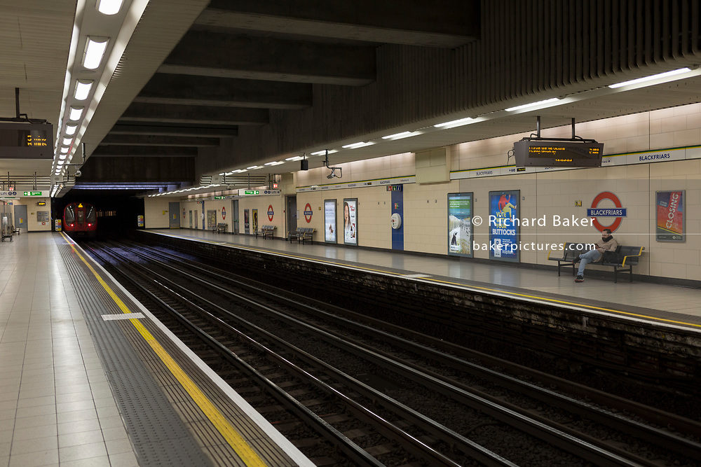 As the Coronavirus pandemic spreads across the UK, businesses and entertainment venues not already closed with the threat of job losses, struggle to stay open with growing rumours of a lockdown and travel restrictions around the capital. Londoners start to work from home leading to very quiet platforms at Blackfriars underground station, on 19th March 2020, in London, England.