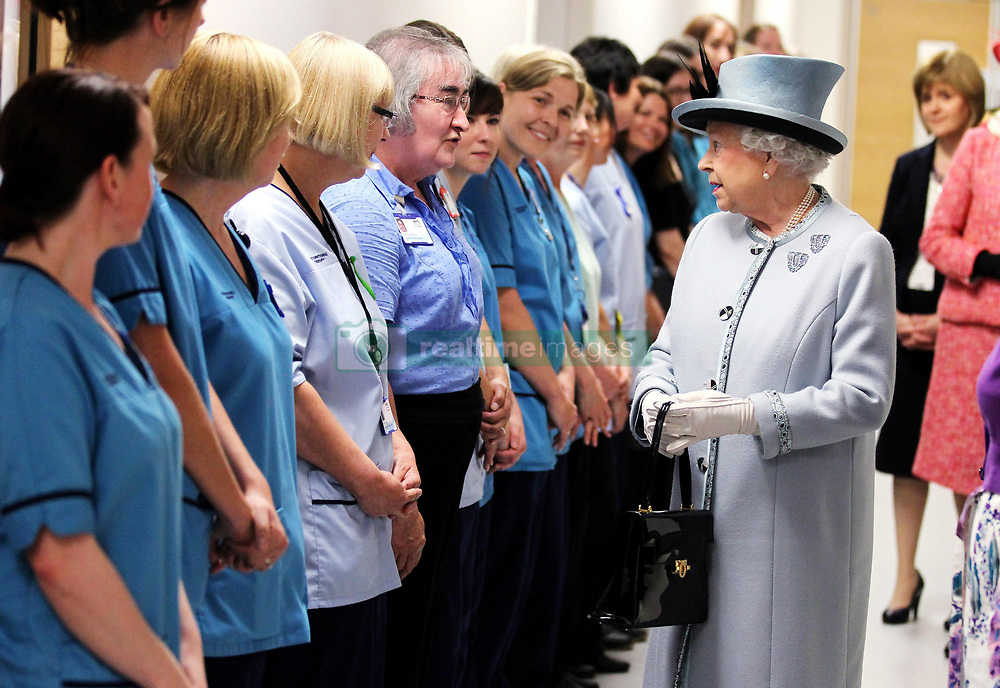 File photo dated 06/07/11 of Queen Elizabeth II meeting NHS staff members at the Forth Valley Royal Hospital in Stirling, which the Queen formally opened, the hospital which cost 300 million, was said to be one of the most modern in Europe. The NHS will celebrate its 70th anniversary on Thursday 5th July 2018.