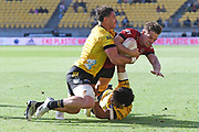 Crusaders George Bridge dives in for a try through the tackle of Hurricanes Devan Flanders in the Super Rugby match, Hurricanes v Crusaders, Sky Stadium, Wellington, Sunday, April 11, 2021. Copyright photo: Kerry Marshall / www.photosport.nz