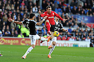 Cardiff city 's Jordon Mutch © is challenged by Southampton's Jose Fonte. Barclays Premier league, Cardiff city v Southampton at the Cardiff city Stadium in Cardiff,  South Wales on Boxing day, Thursday 26th Dec 2013. <br /> pic by Andrew Orchard, Andrew Orchard sports photography.