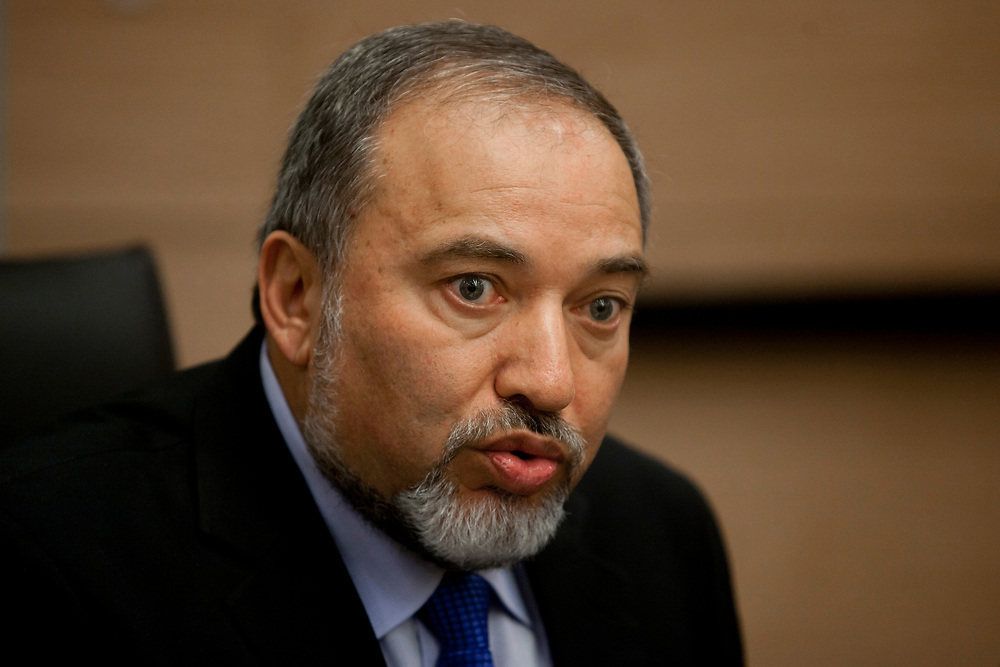 """Israel's Foreign Minister Avigdor Lieberman gestures as he speaks during a meeting with representatives of the """"Suckers' Tent"""" campaign (not pictured), promoting mandatory military service for all sectors of Israeli society, at the Knesset, Israel's parliament in Jerusalem, on May 3, 2012."""