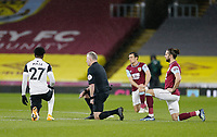 Football - 2020 / 2021 Premier League - Burnley vs. Fulham<br /> <br /> Referee Jonathan Moss and alongside Josh Maja of Fulham and Jay Rodriguez of Burnley take a knee before the kick off to show their opposition to racial discrimination, at Turf Moor.<br /> <br /> <br /> COLORSPORT/ALAN MARTIN