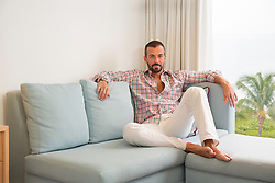 portrait of a handsome man relaxing at home  in Florida