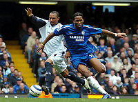 Photo: Ed Godden.<br />Chelsea v West Ham United. The Barclays Premiership. 09/04/2006. Danny Gabbidon (L) and Chelsea's Didier Drogba colide.