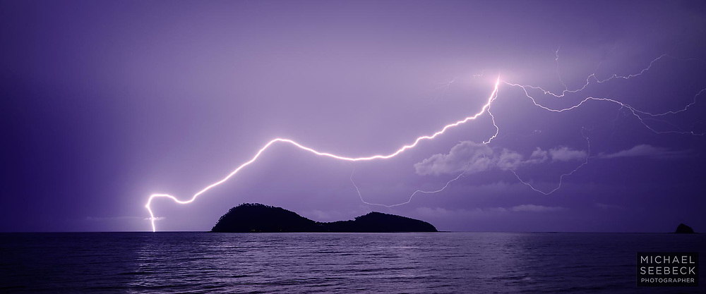 A bolt of lightning strikes the sea near Double Island, Palm Cove, detouring neatly over Double Island.<br /> <br /> Limited Edition of 125
